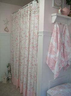 I could take my old shabby chic sheets and make this shower curtain. I love the towel hooks as well.
