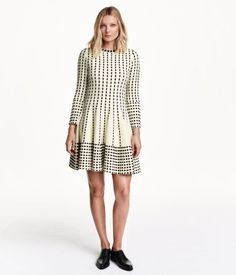 Dress in a soft jacquard knit with wool content. Long sleeves and a circle skirt. Unlined.