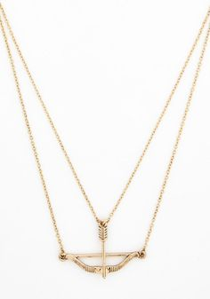 Signed, Sealed, and Quivered Necklace in Gold. When dressing up an outfit, you aim for on-target accessories such as this clever bow-and-arrow necklace - a ModCloth exclusive.