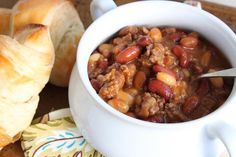 Recipe: Slow Cooker Cowboy Beans - Four different kinds of beans (pinto, baked, kidney and Great Northern) slowly simmered with ground beef and onions. #Recipe by @doughmesstic #crockpot #slowcooker