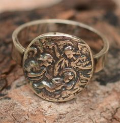 Hey, I found this really awesome Etsy listing at https://www.etsy.com/listing/204950167/rustic-aged-holy-family-ring-in-sterling