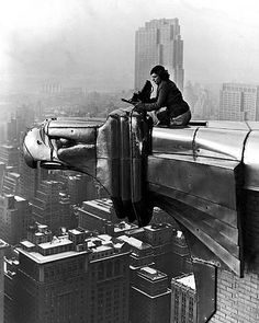 Margaret Bourke-White, Margaret Bourke-White working atop the Chrysler Building, New York, NY; photographed by her assistant, Oscar Graubner