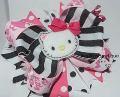 Hello kitty boutique hairbow on barrette by TwinklesBowtique, $12.00