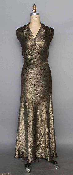 1930s GOLD LAME EVENING GOWN Small abstract patterned lame, bias-cut, V neck w/ halter, low-cut back w/ 2 straps, 2 floating back panels