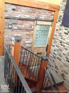 Sliding barn door hardware on brick loft apartment.