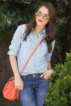red lip, coral purse and denim
