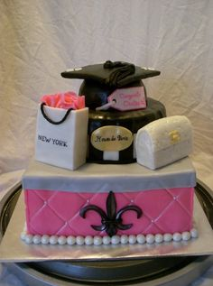 This is a graduation cake. It is a girly-fashion-city cake for a graduation party. This would be PERFECT for my graduation party because I plan on being a fashion designer and live in New York City. I want to design clothes for celebrities, make costumes for movies and plays and also start my own clothing line.