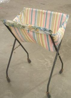 tv tray cart turned laundry basket.....wonder if it would work with wooden ones I have some of those!