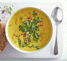 Cheap and cheerful red lentils are jazzed up with coconut milk and plenty of spices in this quick and warming soup recipe