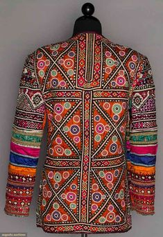 Afghanistan, wedding jacket,  jewel tone satin completely covered w/ colorful embroidery embellished w/ sequins & mirrors, cut out collar, plum rayon lining, 20th c