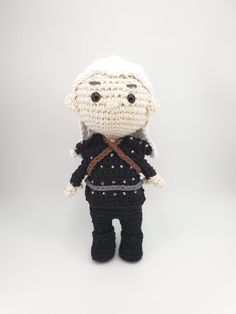 Crochet amigurumi pattern for The Witcher, Geralt of Rivia. Complete with iconic hair, swords and armour. The pattern is available as a standalone pattern or is available as part of an eBook collection with matching Yennefer, Ciri and Jaskier patterns. Single Crochet Decrease, Half Double Crochet, Crochet Patterns Amigurumi, Crochet Hooks, Yennefer Of Vengerberg, Pattern Art, Art Patterns, Cat Crafts, The Witcher
