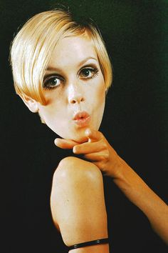 Twiggy 1960s. Clever photograph creating negative space - black top against black background.