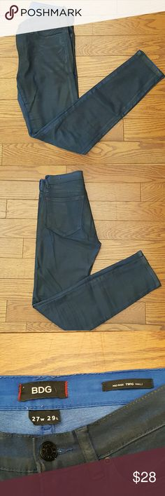 BDG Coated Mid Rise Twig Ankle jeans Great condition BDG Mid RISE Twig Ankle jeans. Dark blue coated skinny jeans. Great way to dress up a casual denim look! Size 27. BDG Jeans Skinny
