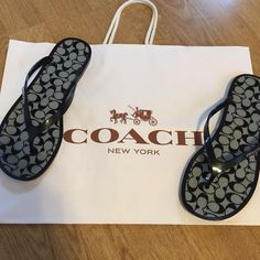 NWOT Coach Jelly Flip Flops Brand new, without tags!! Coach Women's Signature Jelly Thong Flip Flop in Black / Black and White Pattern. These jellies are 100% Authentic Coach, and were retailed at $100 when buying through coach! There is not a flaw on these sandals! Gorgeous! Will fit size 7.5 to a size 8 perfectly! From a smoke free home! Feel free to ask any questions! (: Coach Shoes Sandals