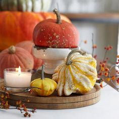 Simple Centerpiece with Mini Pumpkins! More easy decorating with tiny pumpkins and gourds: http://www.midwestliving.com/homes/seasonal-decorating/how-to-decorate-with-mini-pumpkins