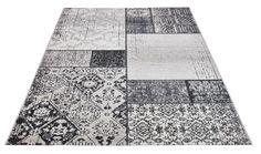 Upea patch work -tyylinen Vintage-matto on helppo puhdistaa ja pitää puhtaana lyhyen nukan ansiosta.