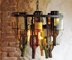 Do-it-yourself wine bottle chandelier. I have plenty of materials, just need to finally do this!