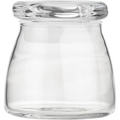 "Glass Spice Jar $1.95. Spice Jar. 4.5 oz.; 2.5""x2.75""H    A unique modern shape that harks back to the charm of old-fashioned dairy bottles, this clear glass spice jar has a tight-sealing lid to keep your favorite flavor accents fresh. Not just for the pantry, it's attractive enough to use on the buffet or dinner table.  Clear glass  Tight-fitting lid  Dishwasher-safe  Made in USA"