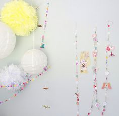 Paper and pom pon wall garland