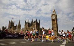 Athletes run near Big Ben during the men's marathon