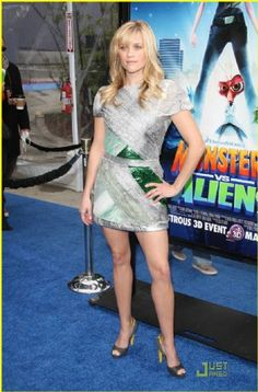 Birthday girl Reese Witherspoon shimmers on the blue carpet premiere of her new animated flick, Monsters vs. Aliens, on Sunday afternoon (March 22) in Universal City, Calif.  The 33-year-old actress stood out in a Rodarte Fall 2009 silver and green dress. She completed her red carpet look with fierce gray and yellow heels.