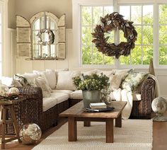 so inviting with all the pillows, love the mirror w/shelf, mercury glass, rug, wreath, tables