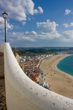 Nazaré, Portugal. The town consists of three sections: Praia (along the beach), Sítio (an old village, on top of a cliff) and Pederneira (another old village, on a hilltop). The Praia and the Sítio areas are linked by the Nazaré Funicular, a funicular railway.
