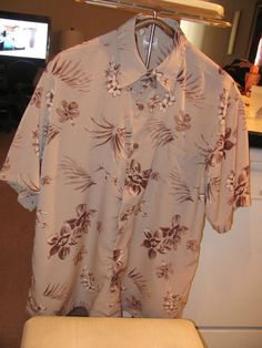 PREMIER INTERNATIONAL MEN    MENS HAWAIIAN PRINT SHIRT    SIZE LARGE    MINT CONDITION    FOR PREOWNED    BEIGE WITH DIFFERENT    SHADES OF BROWN & WHITE HIBISCUS    SEE PICS    50 IN CHEST    30 IN LENGTH    SHORT SLEEVES    AWESOME SHIRT    VERY SOFT AND SILKY SHIRT    WONDERFUL ADDITION    TO YOUR WARDROBE    SELLS FOR 32.00