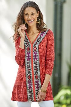 6f37b7fc758 Import a world traveler vibe into your closet with this jersey-knit tunic  fashioned with embroidered front panels against an eye-catching geo-print.