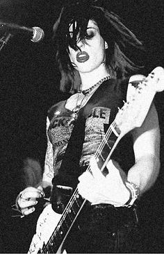 Aussie native Brody Dalle of the LA punk band The Distillers. Formed in 1998 by Brody -- with her distinctively harsh singing voice -- they broke up in 2006.  Although there were significant line-up changes over the years, it was Brody who played guitar, sang, and wrote or co-wrote nearly every song on the band's three albums.