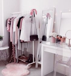 ♡ Wardrobe ♡ Beauty room + makeup vanity with Ikea Malm dressing table and clothing rack. Pink fluffy rug, clear chair, flowers, makeup brushes and pl. Ikea Malm Dressing Table, Dressing Table Organisation, Wardrobe Organisation, Dressing Tables, Organization Ideas, Dressing Design, Clear Chairs, Tumblr Rooms, Glam Room