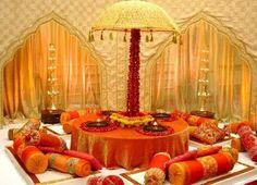 Rajasthani Umbrella Setup for wedding Mehendi seating orange theme