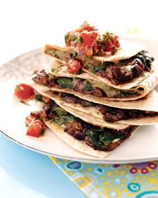 Black Bean Quesadillas | The salsa does more than bring a spicy kick; along with the spinach and whole-wheat tortilla, it contributes fiber. The beans do, too -- and they also lend a protein boost.