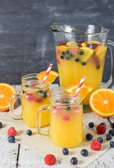 Floating fresh berries in this easy Pineapple Orange Punch is a fun drink for everyone.