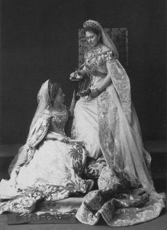 Grand Duchess Elizabeth and a lady in waiting are wearing imperial court dresses.