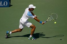 Rogerio Dutra Silva (BRA) hustles to make a play in the second round. - Philip Hall/USTA