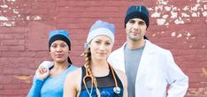 Surgical staff sporting modern and innovative scrub caps.