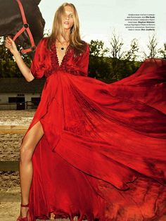 Anna Selezneva looks brilliant in this vivid red Elie Saab Russian couture gown.