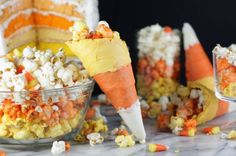 Candy corn cones filled with candy corn popcorn.