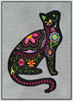 Embellished Cats Your designs will come in two version - one with stitched backgrounds and one with fabric applique backgrounds. Try these kitties in different colors for the background - white, pastels - just about any color so you can match them to any decor!
