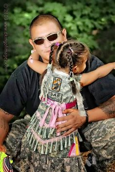 """This sweet little Jingle Dancer, has matching material, just like daddy! It is also may be a statement that she is a """"warrior's"""" daughter."""