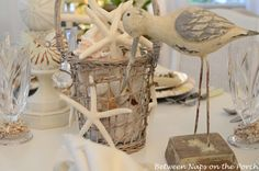 A Beach themed tablescape with shell chargers, shell candle holders, shell centerpiece and shell napkin rings. Coastal Christmas, Christmas 2014, Shell Centerpieces, Shell Candles, Beach Themes, Tablescapes, Shells, Candle Holders, Table Settings