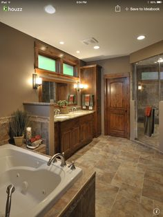 Perfect for our master bath!  Wall color is BM Ticonderoga Taupe. Love stained vanity and large mirror.