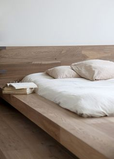 Think big wooden beams for a solid bed with more functional space around.