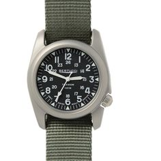 Bertucci 12083 Analog Quartz Green Defender Drab Strap Watch. Scratch-resistant hardened mineral glass crystal, Swiss made all-metal quartz movement, Titanium screw down crown is ergonomically offset at 4 o'clock, Swiss super luminous hands & markers. 12/24 hour markings, titanium band retention lug bars, 100 M water resistance, durability certified Active Comfort, One size fits all, 5 year battery life, 3 year warranty. U.S. patent Nylon band features long lasting easy to clean nylon...