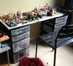 A Lego Desk. Two plastic drawer bins fitted with a top made at Home Depot/ Lowes, with Lego plates glued on. #legodesk