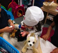 The Vet/Pet Center: Pretend and Learn (Dramatic Play) Center - children use doctor tools to care for little pets during  a community helper unit of study.
