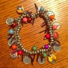 Hindi Indian Talisman Charm Bracelet Krishna Kali Very boho chic. Pewter coins and deities adorn this stretchy bracelet. One size fits most, perfect condition. Jewelry Bracelets