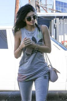 Tie-dye for! Kylie Jenner wears splattered skintight tracksuit #dailymail