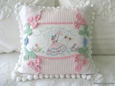 I'm not sure where this photo came from, there was no link.  However, it is a lovely vintage pillow using crocheted motifs and hand embroidery.  Lovely!